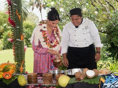 Meghan gets hands-on to help make traditional Fijian dish