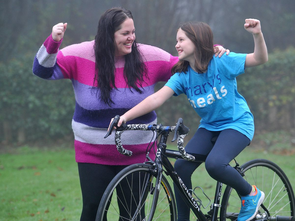Bella Bowater, aged 10, getting moral support from mum Grace