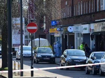 Shop worker stabbed to death in newsagent robbery