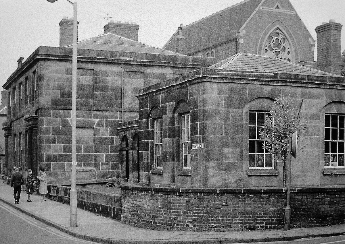 """The long-closed Allatts School, Murivance, Shrewsbury, in 1976, showing windows with """"fern etchings,"""" not that you can make them out. This photo came from the late Jim Stowe of Shrewsbury who said that the etchings – later removed – were the work of students who included his father Sam Stowe who was a boy at the school around 1900."""
