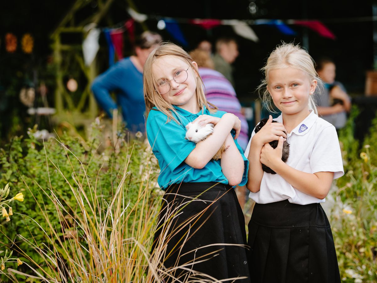 Children at Longlands Community Primary School in Market Drayton have invited local residents into the community to visit their eco-garden and animals. In Picture L>R: Jessica Armstrong 10 with Florence and Charnae Parton 8 with Amelia