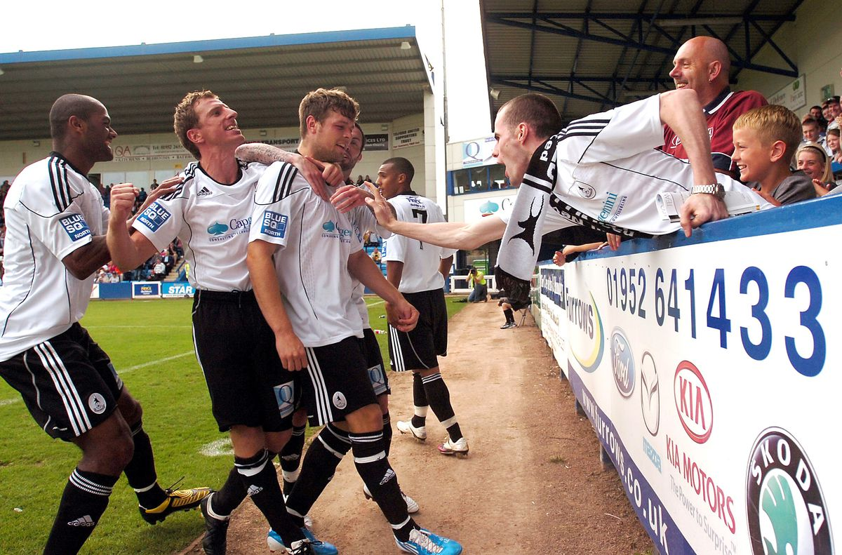 AFC TELFORD UNITED v BLYTH SPARTANS: Telford's Andy Brown celebrates with from left, Phil Trainer and Alex Meechan along with the help of the Telford fans.     PIC BY ANDY CUNNINGHAM: 4/8/10.
