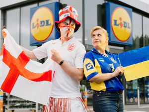 Lidl Madeley store manager Stuart Morris and his deputy Lyuda Alcock ahead of the England vs Ukraine