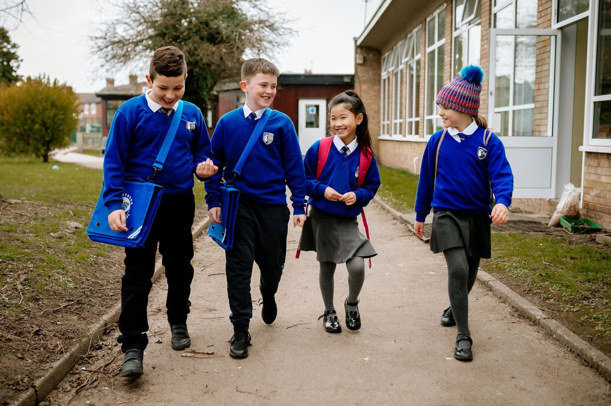 Stepping back to school at Ellesmere Primary School were, from left: Alex Naydenov, eight, Leon Birch, eight, Abigail Yiu, nine, and Kitty Perks, nine