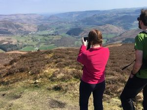 Walkers enjoy the scenery of the Dee Valley above the Horseshoe Pass