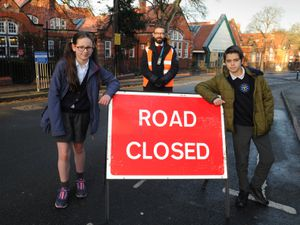 Arriving for school with the road closed, pupils Immy Felton, 11, and Zach Williams, 11, with deputy head Tom Larkham