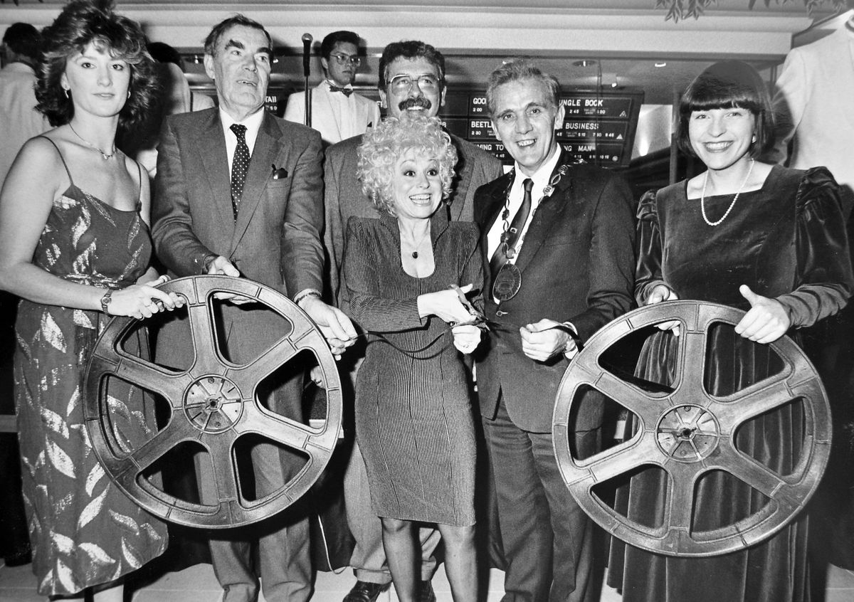 Let's remember Barbara Windsor and the night she came to Telford to open the town's first multi-screen cinema. The date was November 3, 1988, and she cut a reel of film to open the new AMC 10-screen cinema complex – it's now the Odeon – flanked by, from left, Vicky Humpish, office manager, Telford Development Corporation chairman Frank Jones, AMC managing director Millard Ochs, Wrekin Council chairman Jim Hicks, and Janie Banks, deputy general manager. The opening included a stunning firework display, claimed by the organisers to be the largest land-based firework display in the country that year.