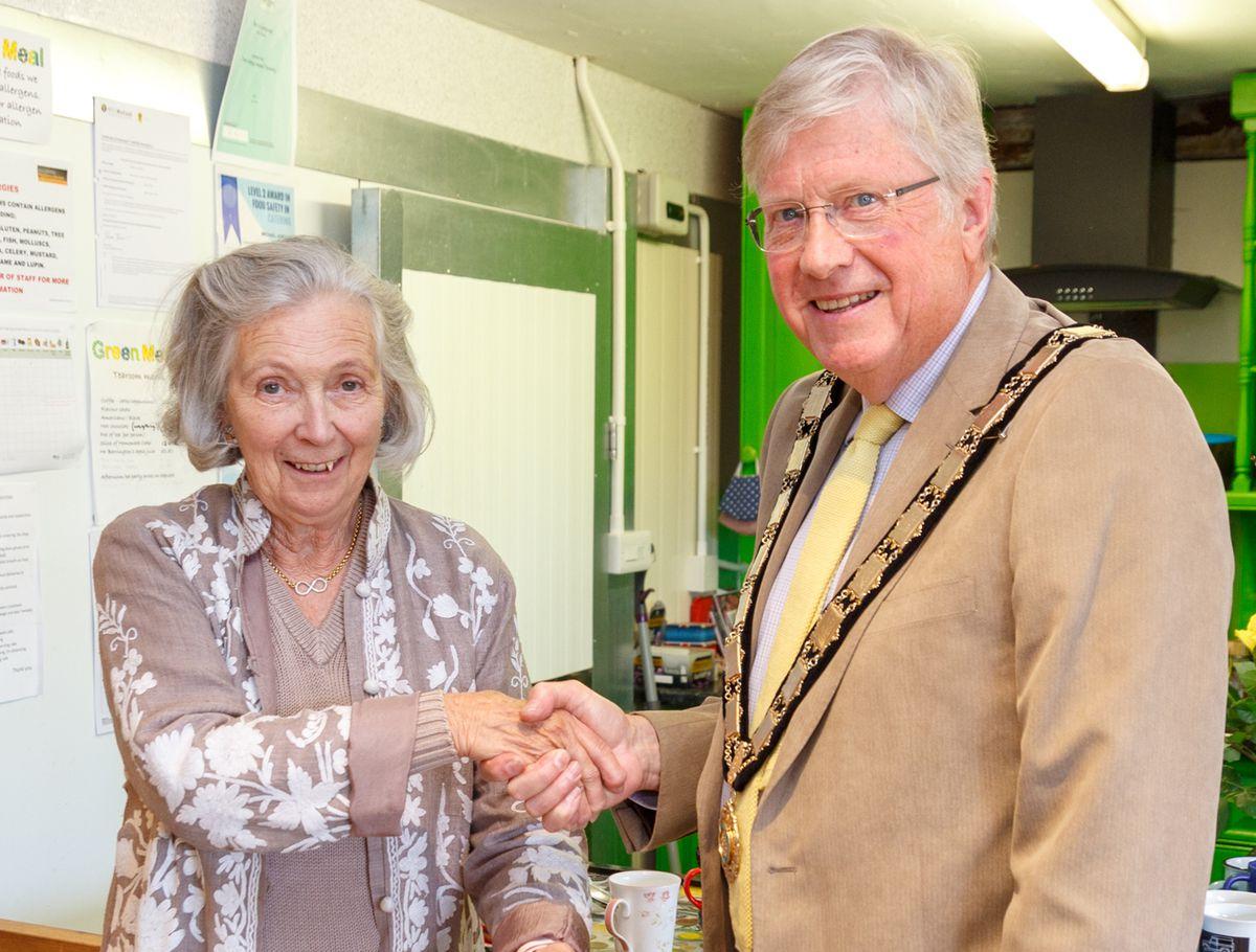 Mayor of Tenbury, Councillor Eric Hudson presents the Malvern award to Tenbury Transport patron Angela Brinton