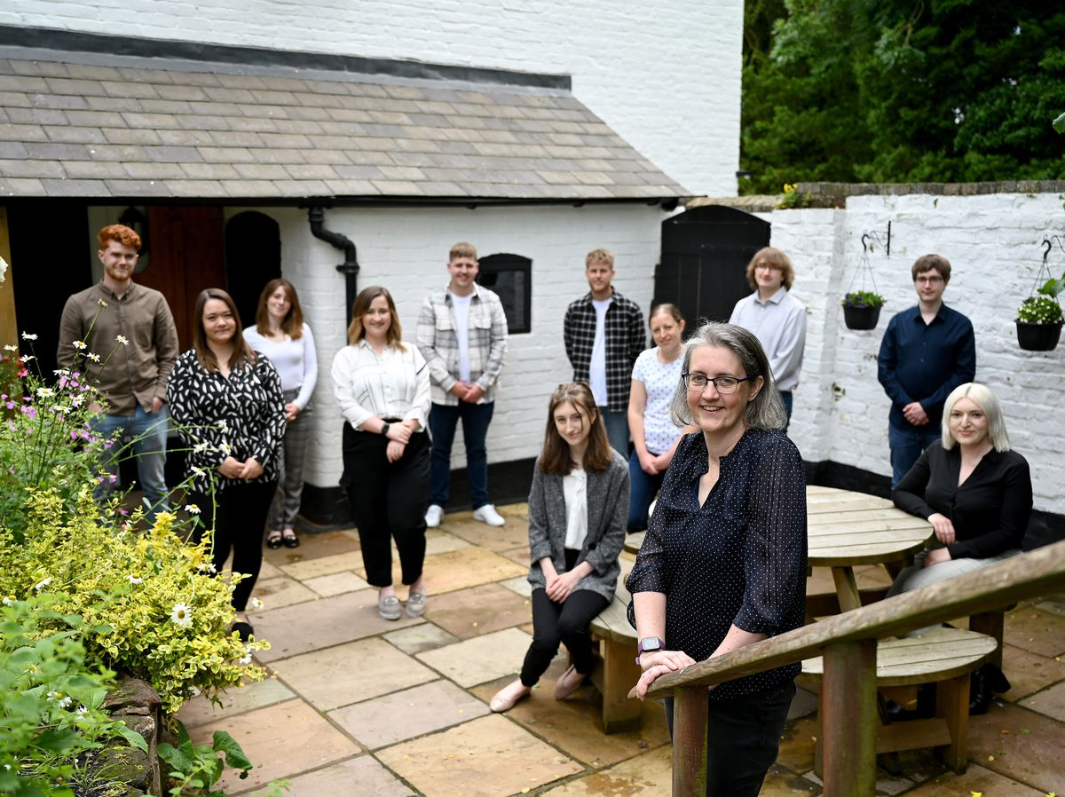 Helen (front) with her team at their historic home.
