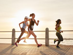 A generic stock photo of a couple exercising in the sun.
