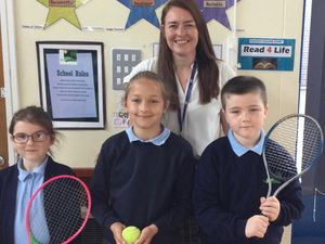 Amy Brentnall, a Year 3 teacher at Meadows Primary School, who won the prize for the school, with Year 3 pupils Jack, Caitlin and Anna, who asked tennis players Aniek van Koot and Abbie Breakwell questions.