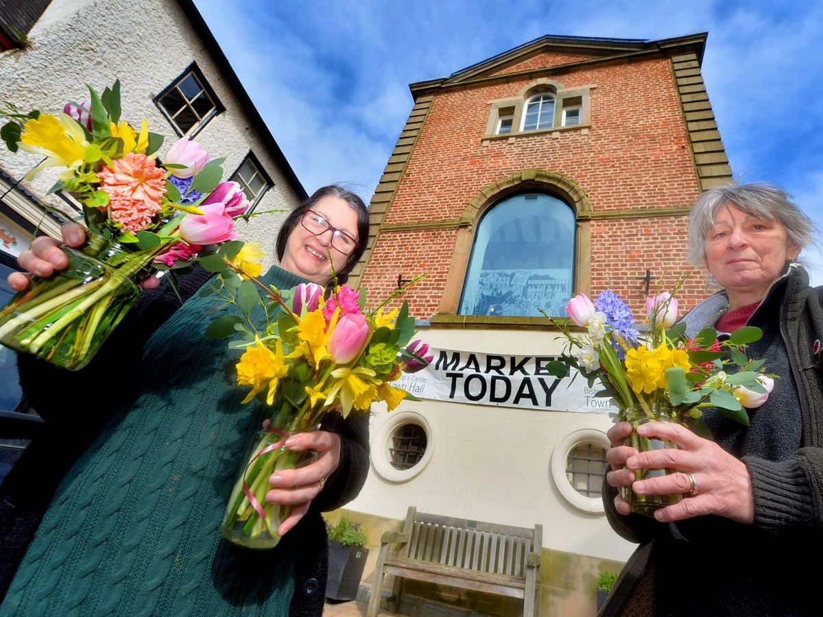 Sue Willmer, Bishop's Castle Town Hall Manager, and Mrs Newman with flowers by Janice Bateson, Cottage Garden Flowers