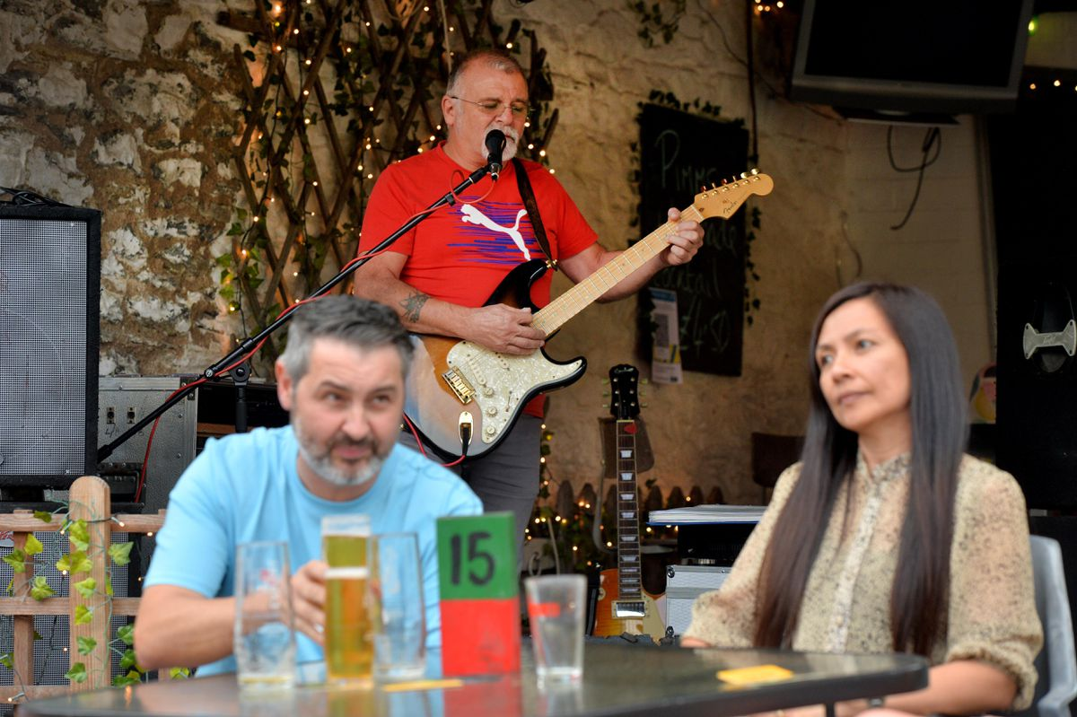 Drinkers enjoying the afternoon at the Six Bell's during the Michaelmas Fair