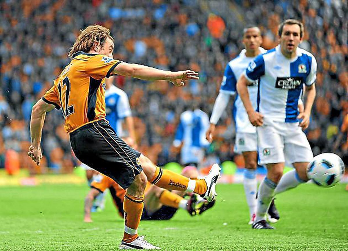 Stephen Hunt curls home the goal that saw Wolves safe on the final day of the 2010/11 season