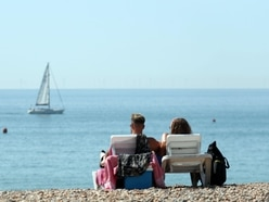 In Pictures: Sun-seekers soak up rays as temperatures soar