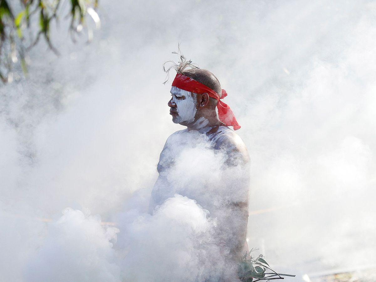Russell Dawson of the Koomurri Aboriginal Dancers participates in a smoking ceremony during Australia Day ceremonies in Sydney