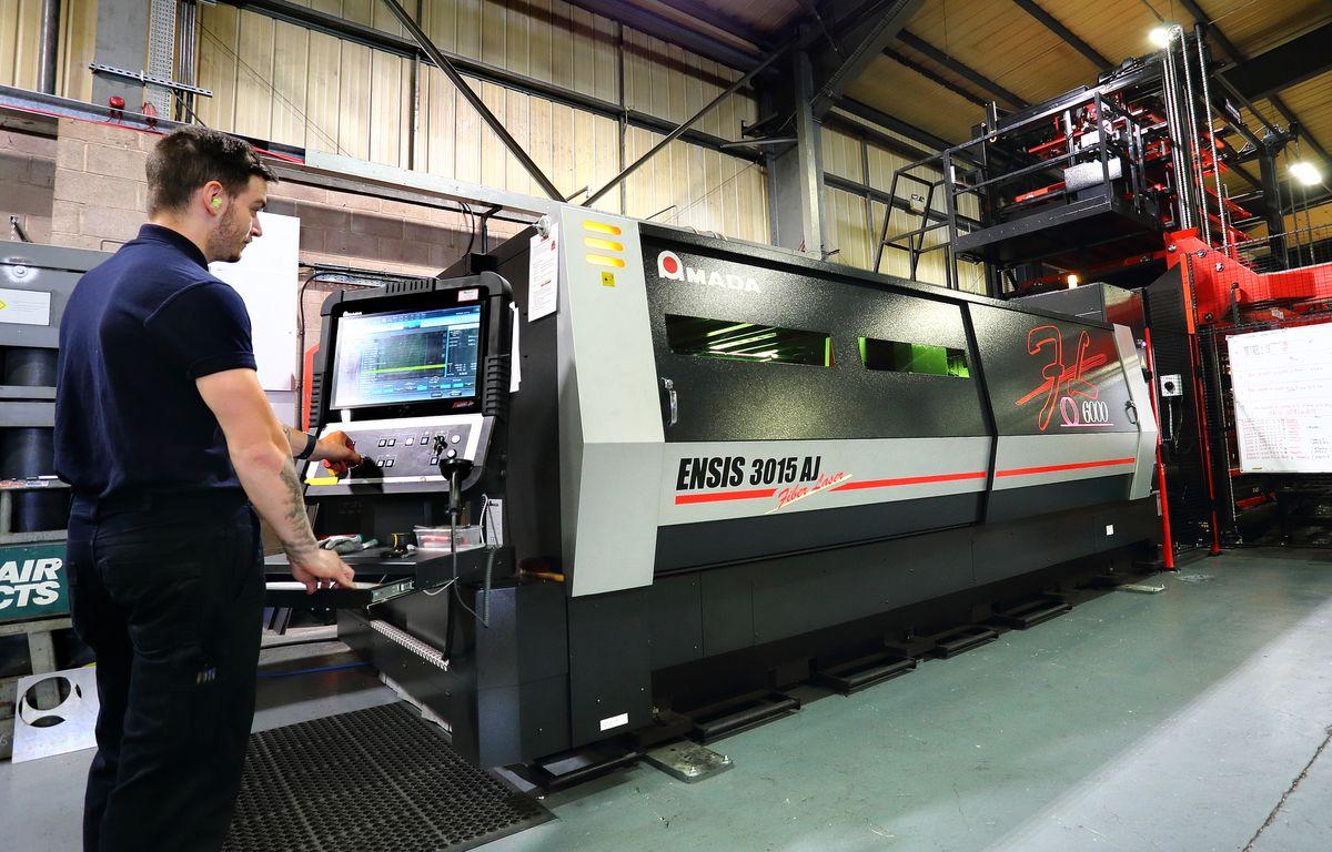 Dean Austin operating the new Amada 6KW Ensis Fibre laser cutter