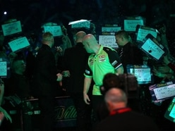 Van Gerwen opens with a win after having beer thrown at him at Alexandra Palace