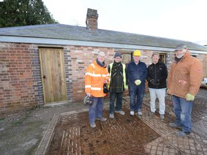 The team taking part in the restoration of the weighbridge building on the old railway site in Bishops Castle. Pictured L-R: Peter Broxholme, Roger Dalton, Mike Boyd, David O'Neill and Malcol Reeves.