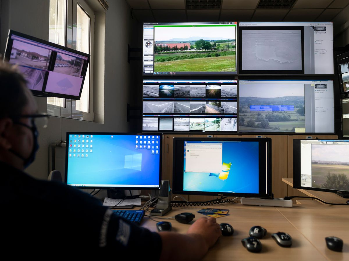 A police officer works inside the operation centre at the village of Nea Vyssa, near the Greek-Turkish border, in Greece