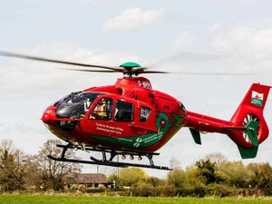 Woman airlifted to hospital after car crashes into house