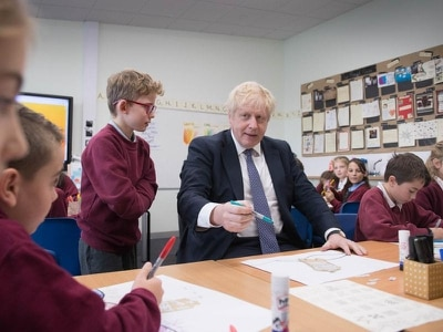 Wheels staying firmly on the bus, says Johnson on school visit