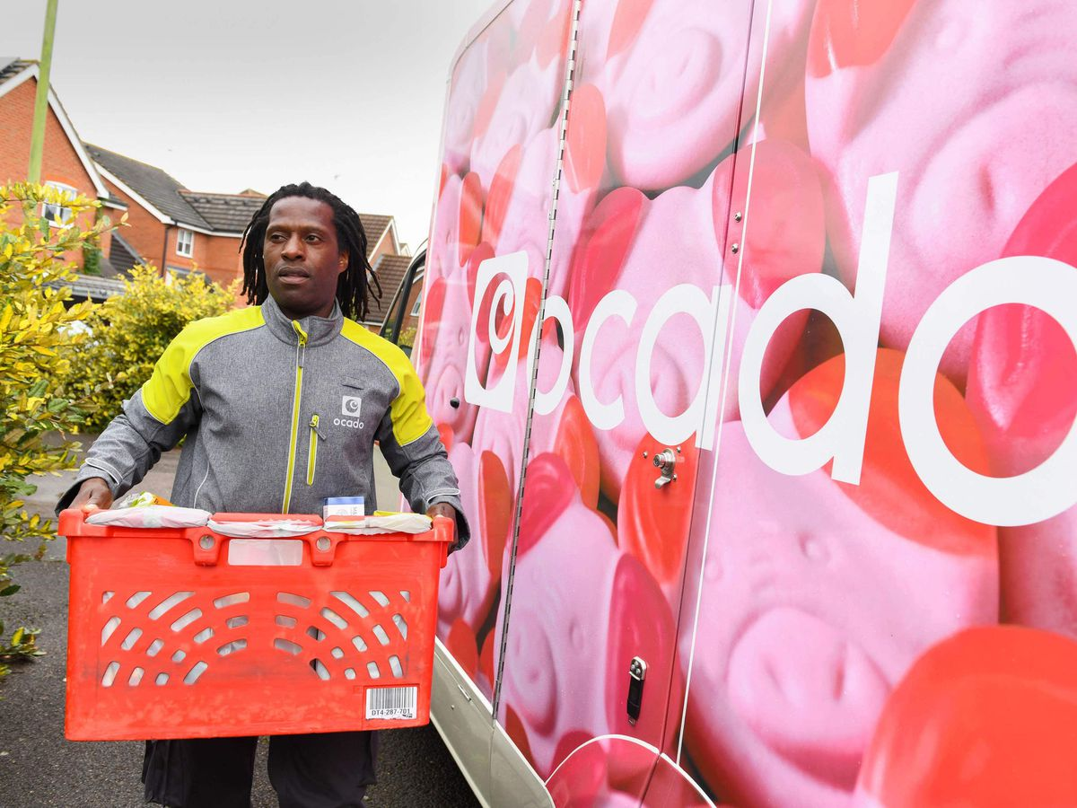 An Ocado delivery driver and van