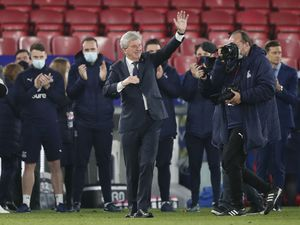 Crystal Palace manager Roy Hodgson salutes the fans