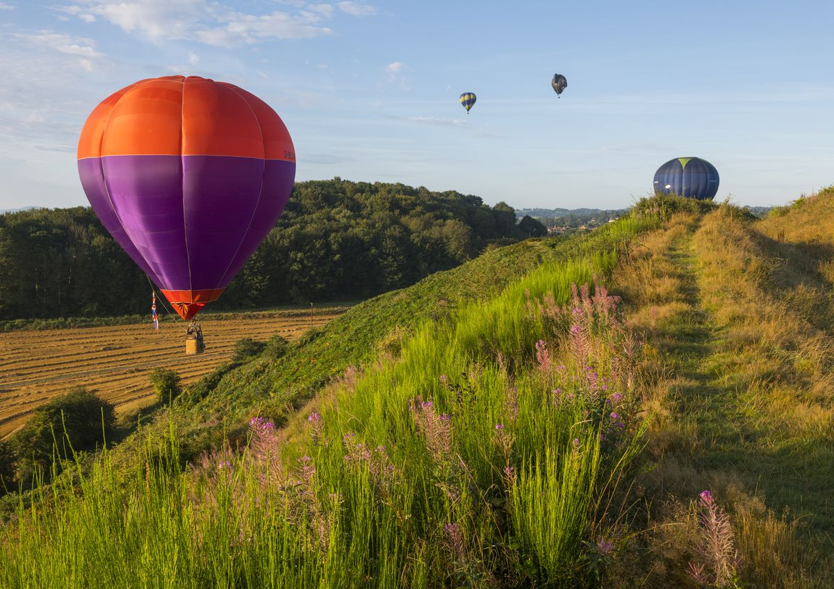 Hot air balloons get a close look at Old Oswestry hill fort during the annual Oswestry balloon carnival.