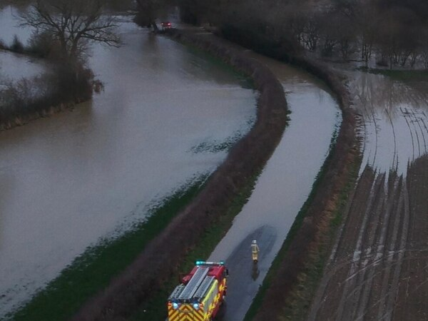 Mid Wales and Oswestry roads and businesses hit by floodwaters
