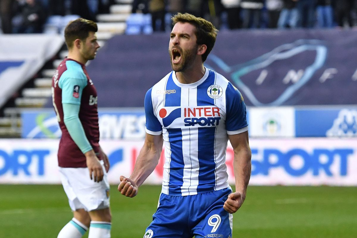 Will Grigg in goalscoring action for former club Wigan