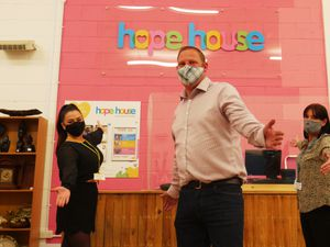 Ready to return at the Hope House shop in Harlescott are manager Adam Sager (centre) with assistant managers Hannah Roberts (left) and Joanne Lee