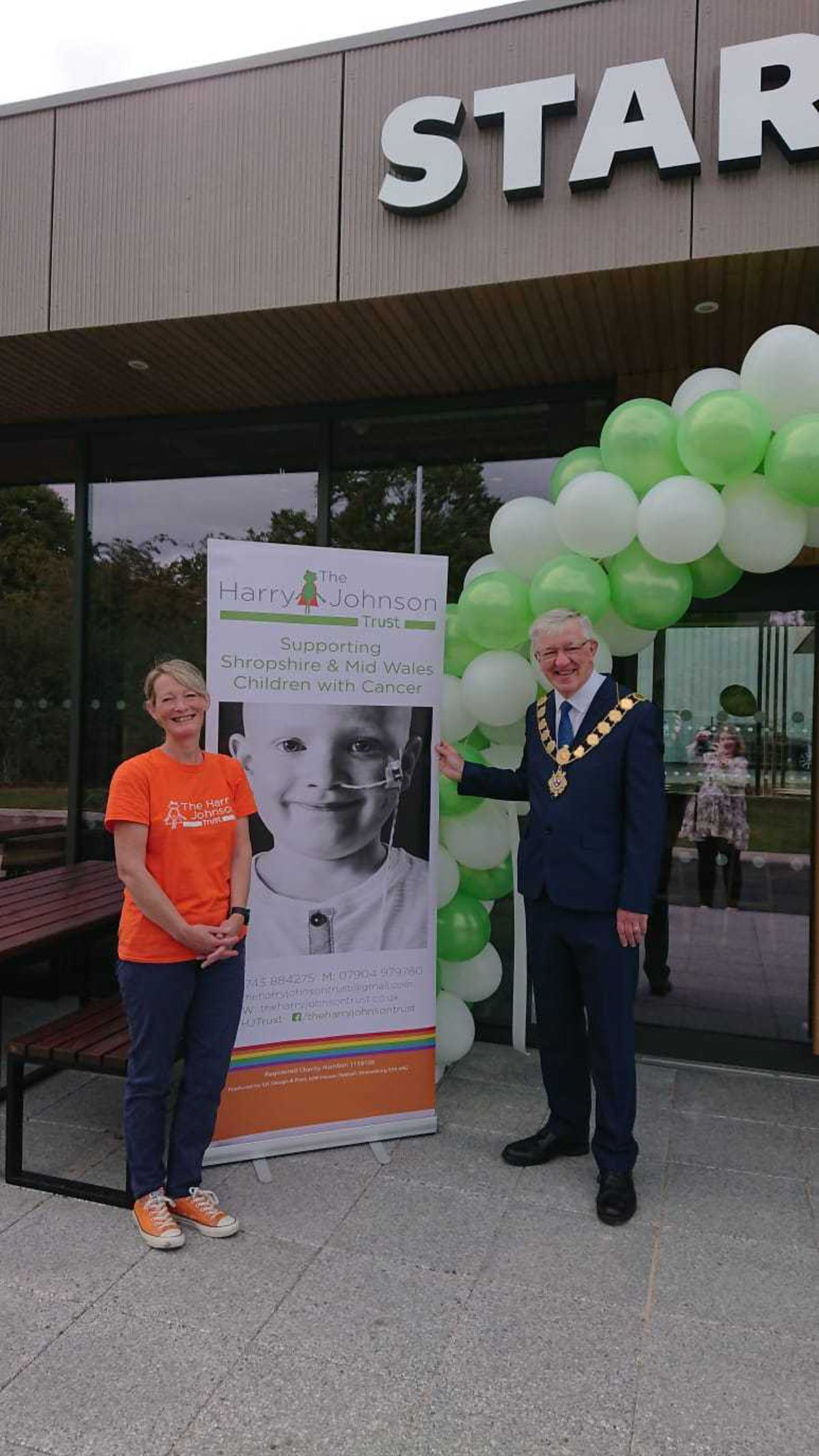 A representative from the Harry Johnson Trust, the store's charity partner, with the mayor of Shrewsbury, Phil Gillam