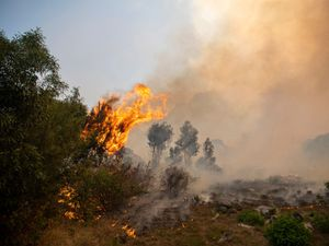 A fire rages out of control on the slopes of Table Mountain in Cape, South Africa