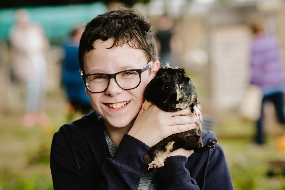 Children at Longlands Community Primary School in Market Drayton have invited local residents into the community to visit their eco-garden and animals. In Picture L>R: Former pupil and local resident, Alex Keen 12 with Freya