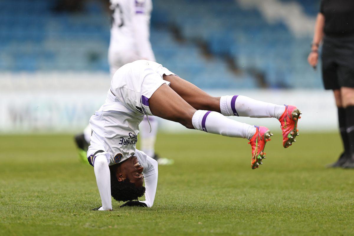 Nathanael Ogbeta of Shrewsbury Town does a backwards roll of shooting at goal.