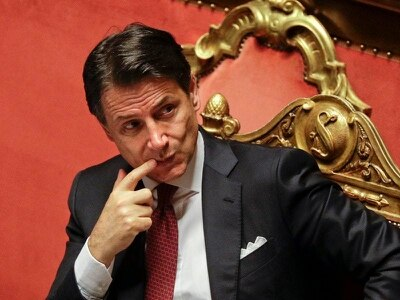 Italian PM asked to stay as caretaker leader after resignation