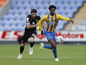 Nathanael Ogbeta of Shrewsbury Town and Troy Parrott of MK Dons. (AMA)