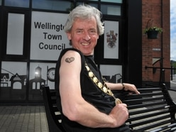 Mayor braves the needle to get permanent tribute to Wellington