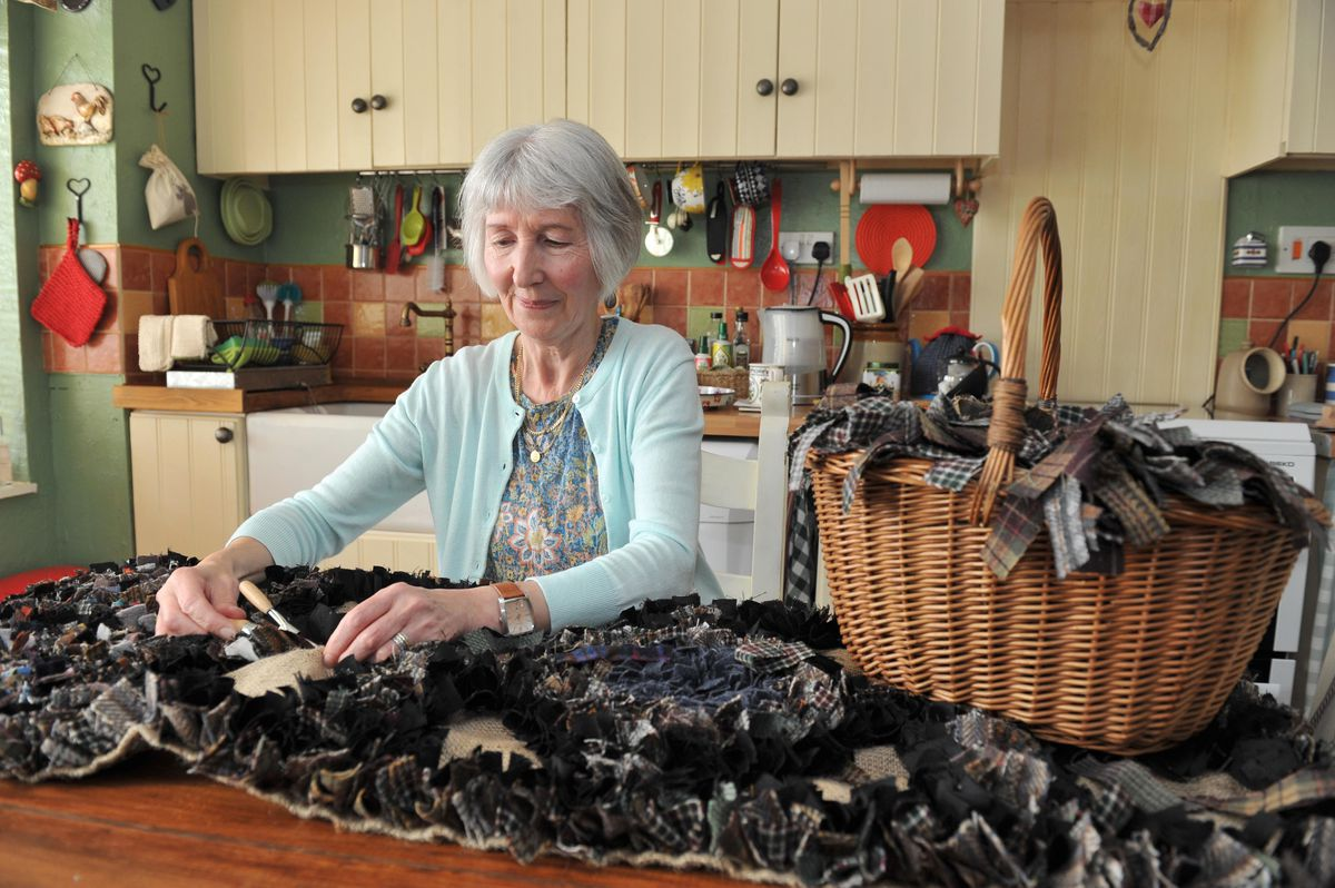 Stephanie with the rug she has made for the bothy at Attingham Park