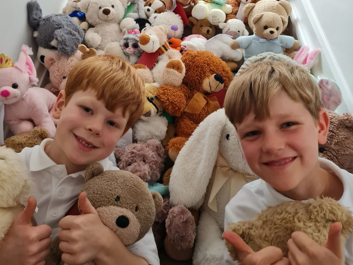 Charlie and Liam with the teddy bears they collected at their home in Market Drayton