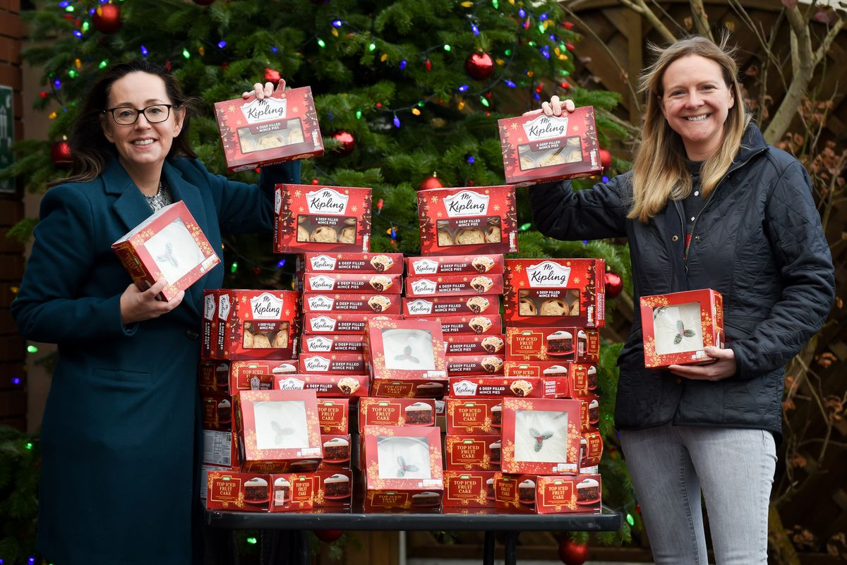 Amy Bould, left, hands over the foodbank donations to Sallie Allen ahead of hampers being distributed to families in need in the Newport area.