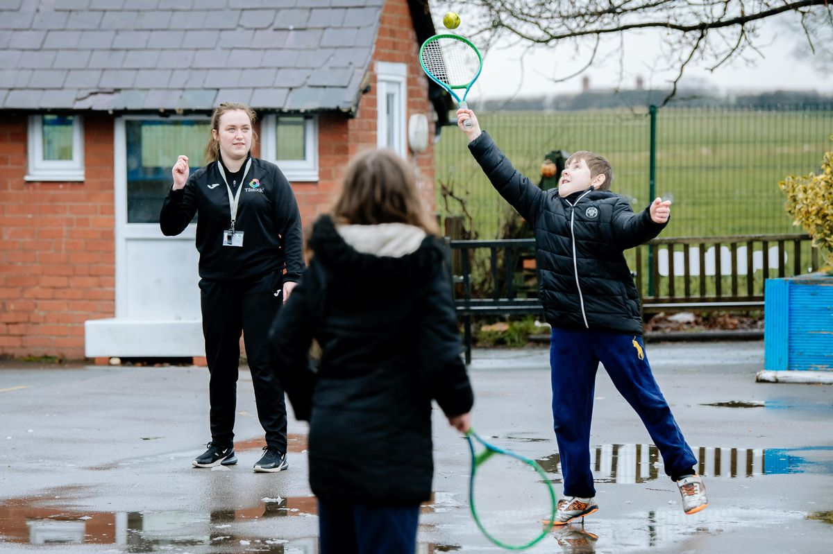 Ariana Smith teaches tennis to Benji Sambrook, aged 9, and Ellie Neves-Hill, 10, at Tilstock Primary School in Whitchurch