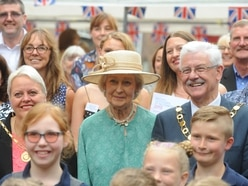 Smiling in the rain as Princess Alexandra meets Telford community heroes