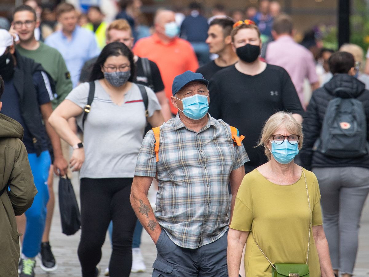 People are being urged to wear masks to help slow the spread of Covid: Dominic Lipinski/PA Wire
