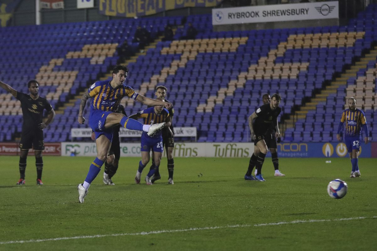 Oliver Norburn of Shrewsbury Town scores a goal to make it 2-0 from the penalty spot (AMA)