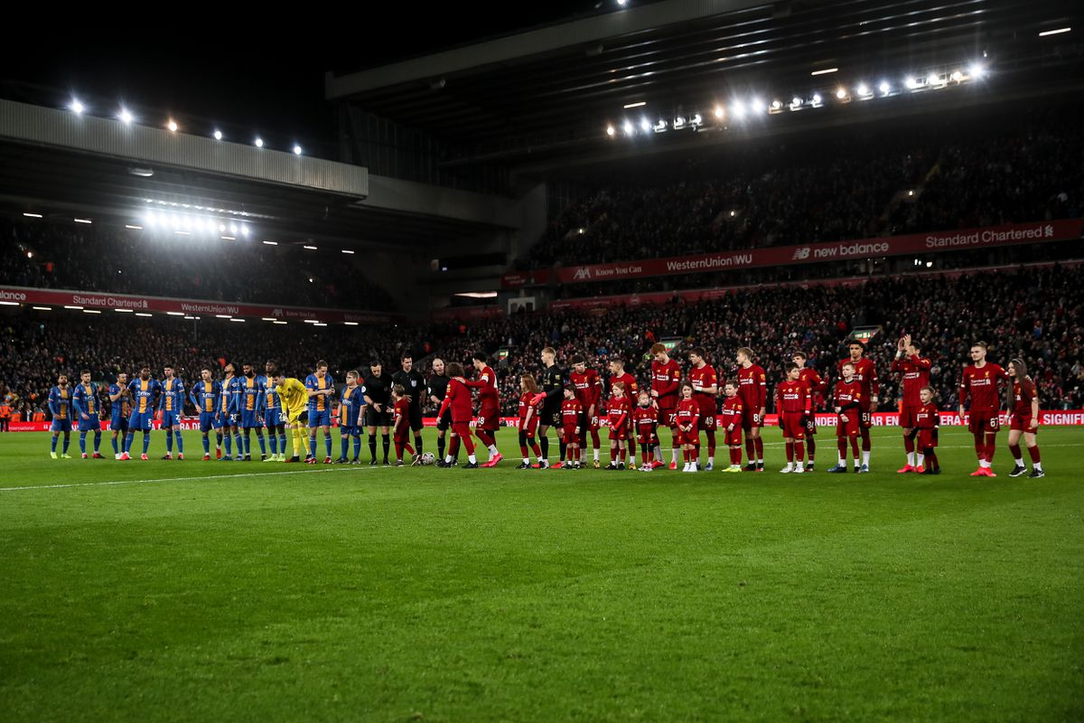 A general view as both teams line up at Anfield, home stadium of Liverpool, for Town's FA Cup fourth round replay in February 2020 (AMA)