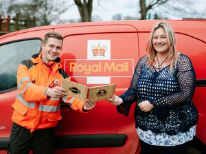 Sarah Garbett surprised her postman Dave Hart with a Thank You book from the local community