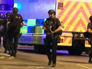 Police near the Manchester Arena after the terror attack at an Ariana Grande concert