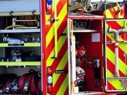 Car on roof after crash in village near Shrewsbury